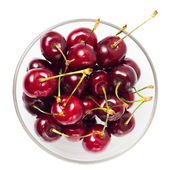Fresh Cherry in glass bowl isolated on white — Stock Photo