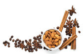 Almond nuts with coffee beans and spices isolated on white background — Stock Photo