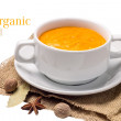 Orange pumpkin soup at old fabric isolated on white background — Stock Photo