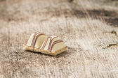 Candy on weathered wood board — Stock Photo