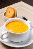 Pumpkin soup in white bowl with crouton — Stock Photo