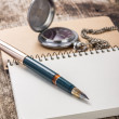 Stockfoto: Blank Pocketbook with ink pen and old pocket watch