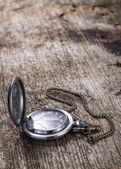 Old pocket watch on wood background with copyspace — Stock Photo