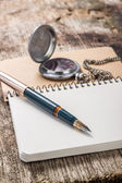 Blank Pocketbook with ink pen and old pocket watch — Stock Photo