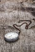 Old pocket watch at wood background — Stock Photo