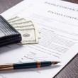 Financial document with wallet, money and ink pen — Stock Photo