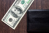 Money with leather wallet on table — Stock Photo