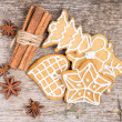 Gingerbread cookies with spices on wood background — Stock Photo #33699607