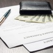 Financial document with wallet, money and fountain pen — Stock Photo