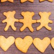 Gingerbread cookies bear in dance with hearts — Stock Photo