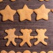 Gingerbread cookies bear in dance with hearts and stars — Stock Photo