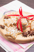 Christmas Gingerbread cookies on wooden round board — Stock Photo