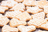 Gingerbread iced cookies on table — Stock Photo