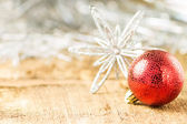 Christmas decoration. Ball with Snowflake on wooden board — Stock Photo