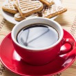 Cup of coffee with gingerbread cookies. — Stock Photo