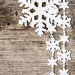 Christmas decoration. Snowflake ornament on wooden background — Stock Photo
