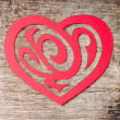 Red Paper Cut out Heart with ornament on wood — Stock Photo