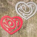 Two Paper Heart Ornamental Shape on wood — Stock Photo