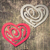 Two Paper Heart Ornamental Shape on wood — Stock Photo