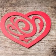 Red Paper Cut out Heart with ornament on wood — Stock Photo #38253781