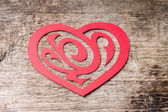 Red Paper Cut out Heart with ornament on wood — Stok fotoğraf