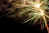 Colorful fireworks over dark sky — Stock Photo
