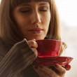 Pretty Woman with Coffee or Tea near Window — Stock Photo