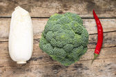 Broccoli, Chinesse Cabbage and Red Chilli Pepper on grunge woode — Stock Photo