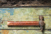 Old rustic hammer on wood background — Stok fotoğraf