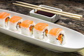 Seafood Sushi rolls in White Long Dish with soy sause — Stock Photo