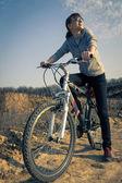 Young girl resting in biking trip — Stock Photo