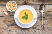 Meal time. Pea soup served on grunge wood table with spices — Stock Photo