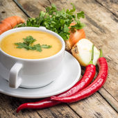 Organic food. Pea soup with vegetables around on wood background — Stock Photo
