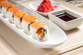 Seafood Sushi rolls in White Long Dish with soy sauce — Stock Photo