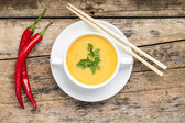 Creative cuisine. Pea Soup with chopstick on wood background — Stok fotoğraf