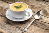 Vegetarian food. Pea soup with silver spoon — Stock Photo