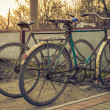 Two old bicycles at the village parking — Stock Photo #44328881