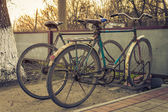 Two old bicycles at the village parking — Stock Photo