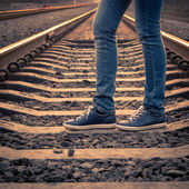 Woman walking on railroad. Female legs on the road — Photo