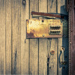 Rusty Security Lock at the Old Wooden Door — Stock Photo #45941867