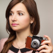 Young hipster woman make a photography with old camera — Stock Photo #51198275