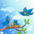Blue bird family with snow background — Stock Vector #12229020