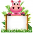 Stock Photo: Cute hippopotamus with board