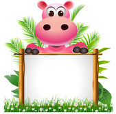 Cute hippopotamus with board — Stock Photo