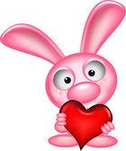 прекрасный кролик держит влюбленное сердце — Cтоковый вектор
