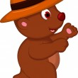 Cute brown bear cartoon with hat walking — Stock Vector #40707621