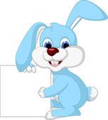 Rabbit cartoon holding blank sign — Stock Vector