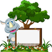Funny rhino cartoon with blank sign on garden — Stock Vector