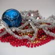 Christmas ball with silver chain — Stock Photo