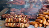 Barbecue dinner skewers shish kebab and other meat — Stock Photo